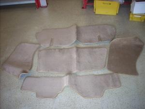 beige rear carpet set behind eats spider